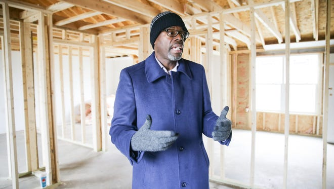 Anthony Murdock, executive pastor at Eastern Star Church in Indianapolis, stands inside a five-bedroom home in the process of being rehabbed on Priscilla Avenue, where the church has built some new homes and rehabbed others through the Rock Initiative on Monday, April 9, 2018.