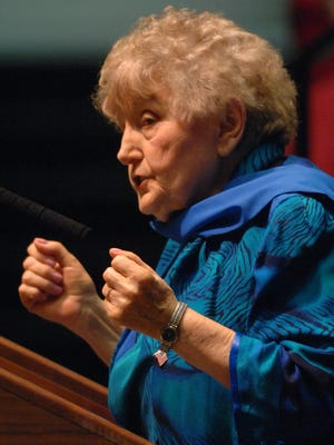 World War II Holocaust survivor Eva Kor describes how she fought the guards when they tried to tattoo a number on her arm during a lecture to students in Civic Hall Wednesday afternoon.