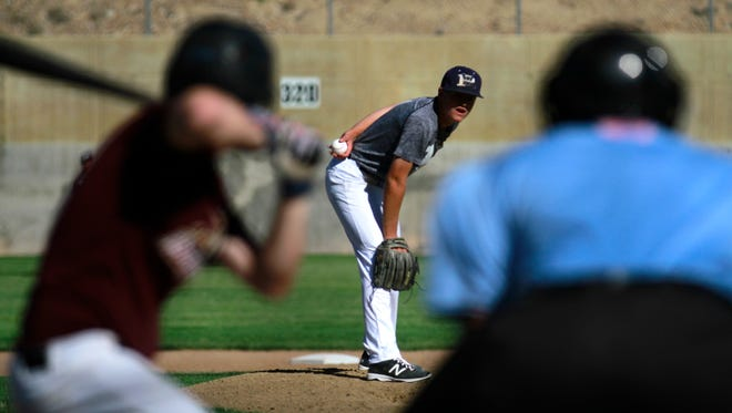 Rivercats' Grant Bessey pitches against the Pumpjacks on Monday at the Farmington Sports Complex.