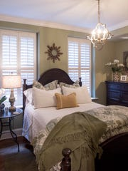 The welcoming guest room with its high bed. There is