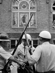 In this Sept. 15, 1963 file photo, police officers