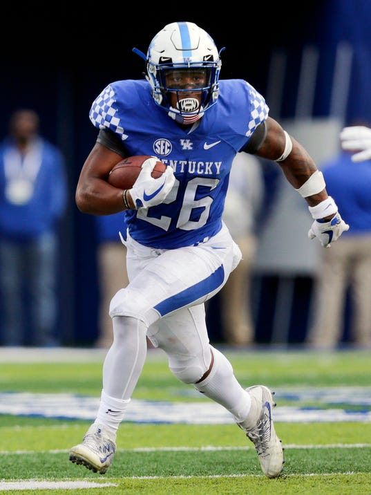 FILE - In this Nov. 4, 2017, file photo, Kentucky running back Benny Snell Jr. runs the ball during the first half of an NCAA college football game against Mississippi, in Lexington, Ky. Snell Jr. was selected to the AP All-Conference SEC team announced Monday, Dec. 4, 2017. (AP Photo/David Stephenson, File)