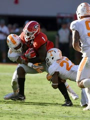 Tennessee defensive back Todd Kelly Jr. (24) and Micah Abernathy (22) stop Georgia tailback Sony Michel (1) during their 34-31 win over Georgia at Sanford Stadium Saturday, Oct. 1, 2016 in Athens, Ga.