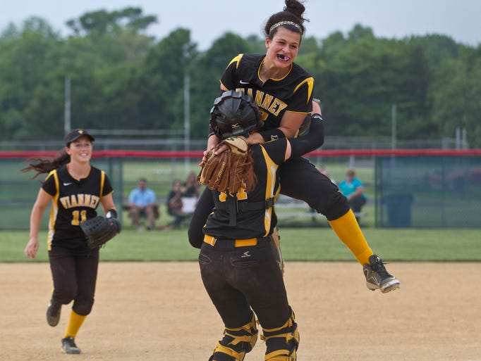 SJV's pitcher Ashley Ventura jumps into the arms of catcher Michelle King after winning the game. Shore Conference Tournament softball championship game featuring St. John Vianney and Pinelands Regional. Wall, NJ Wednesday, June 4, 2014 Doug Hood
