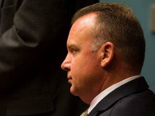 Wilmington Police Chief Robert Tracy listens to the