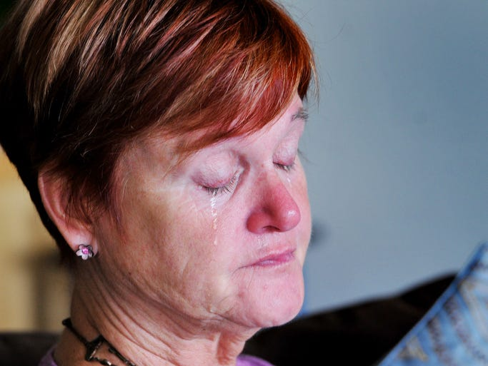 Gay Hofmann, 60, of Cape Canaveral, sheds tears as she talks about the uncertainty of her future following the loss of her husband, Hank.