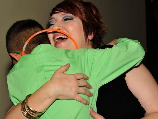 Jennifer Sanchez gets a hug from her nephew Nick Ybarra