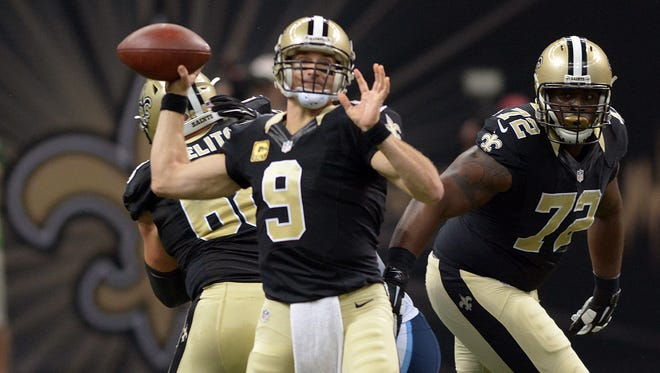 Saints quarterback Drew Brees throws a pass during a game against the Tennessee Titans at the Mercedes-Benz Superdome in New Orleans Sunday, Nov. 8.
