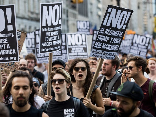 NEW YORK, NY - AUGUST 13: Protestors rally against