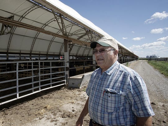 Duane Hord talks about his cattle on his farm outside