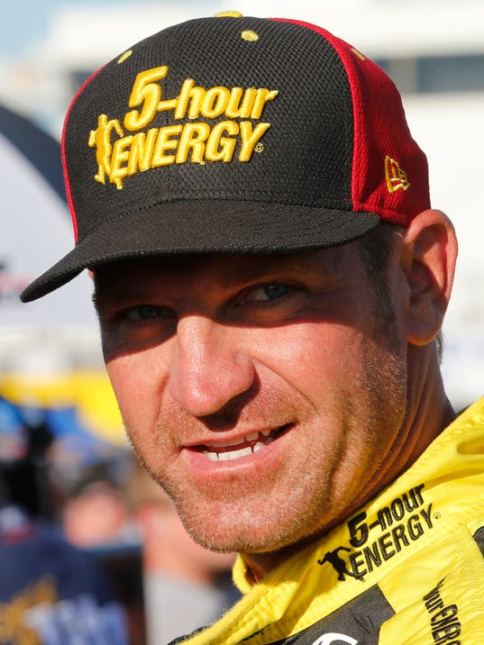 Clint Bowyer prior waits for qualifying for Saturday's NASCAR Sprint Cup auto race at Richmond International Raceway in Richmond, Va., Friday, Sept. 11, 2015. (AP Photo/Steve Helber)