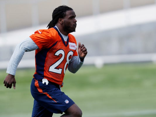 File-This May 23, 2017, file photo shows Denver Broncos running back Jamaal Charles running between watching drills at NFL football organized team activities at the team's headquarters in Englewood, Colo. The Denver Broncos will soon discover if Charles is still Jamaal Charles. Coach Vance Joseph says he'll take the bubble wrap off the veteran running back sometime this preseason but he isn't sure if that will be against the 49ers, Packers or Cardinals. (AP Photo/David Zalubowski, File)