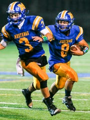 Manville's TJ Caswell (8), right, rushes behind blocking from Shane Demeter (3) against South Hunterdon at Manville on September 30, 2016.