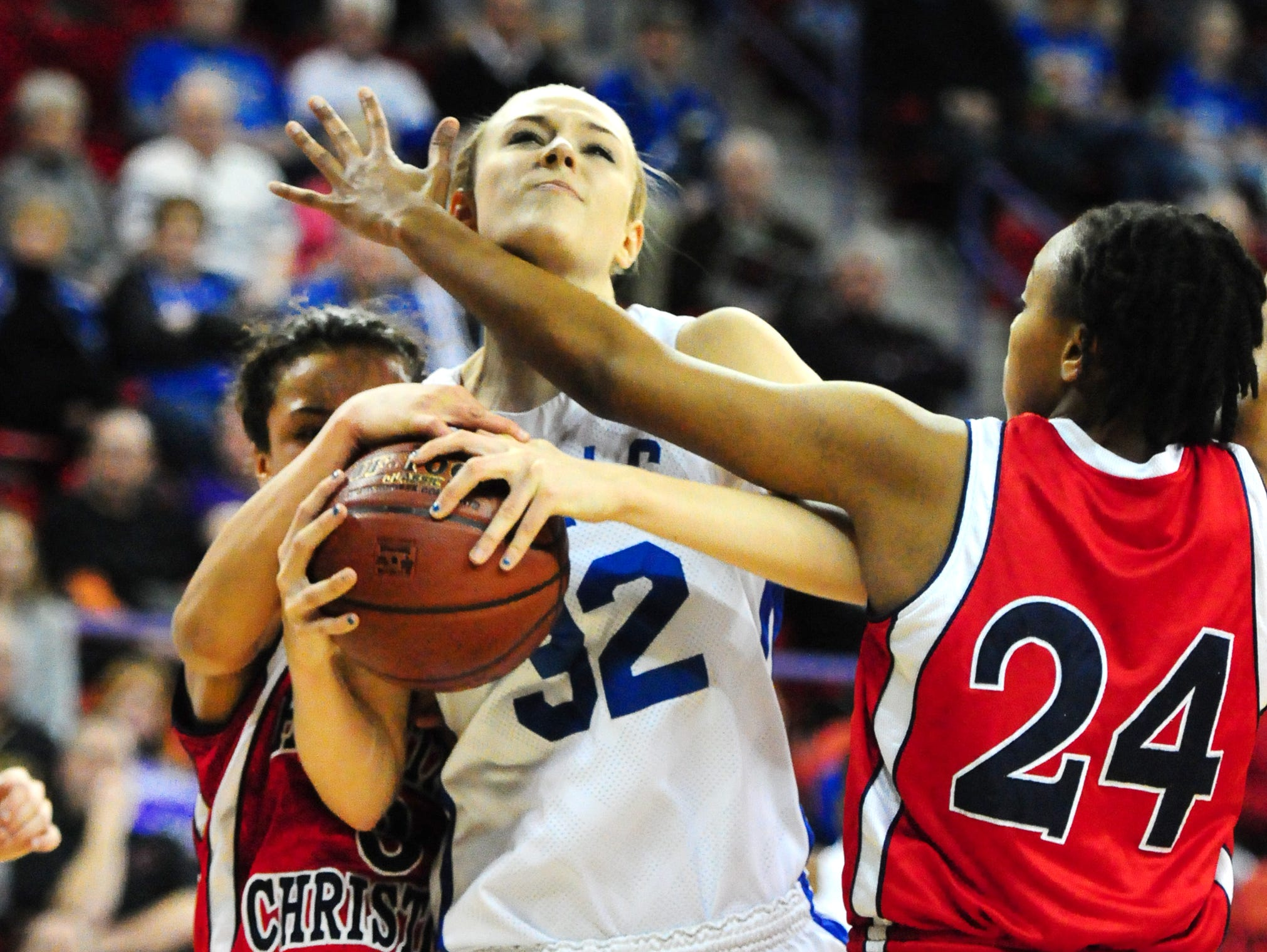 Assumption's Gena Grundhoffer is guarded during a WIAA Division 5 state semifinal against Heritage Christian last season. The Royals have earned a No. 1 seed for this year's postseason