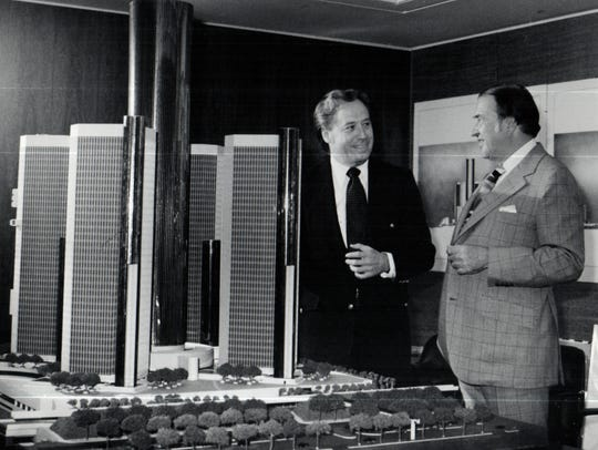 John Portman, left, architect for the Detroit riverfront