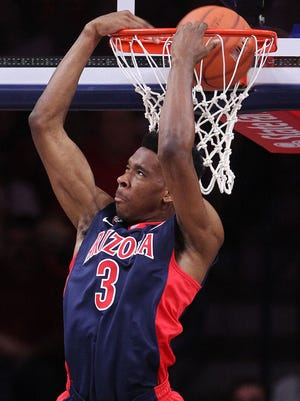 Arizona Wildcats guard Justin Simon dunks during warm-ups prior to the annual Red-Blue Game in Tucson on Saturday, Oct. 17, 2015.