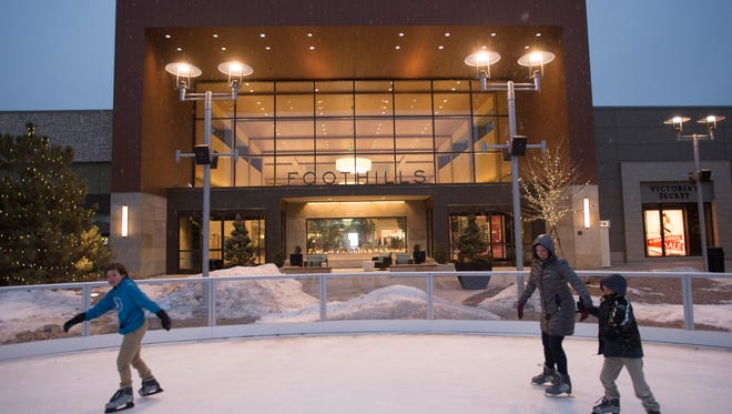 People skate on the ice rink at Foothills mall on Wednesday, January 11, 2017. The mall's east lawn has become a hub for dining and entertainment in Midtown Fort Collins.