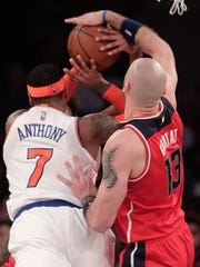 Wizards center Marcin Gortat (13) blocks a shot by Knicks forward Carmelo Anthony (7) during the second quarter of an NBA basketball game, Thursday, April 6, 2017, in New York.