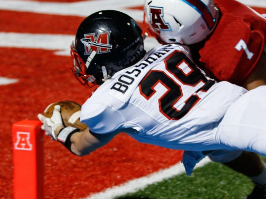 Muskego running back RJ Bosshart (29) dives in for a touchdown during the game at Arrowhead on Thursday, Aug. 24, 2017.