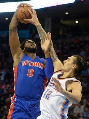 Thunder center Steven Adams (12) blocks a shot by Pistons center Andre Drummond (0) during the first quarter at Chesapeake Energy Arena.