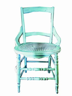 Delicate etches add interest to a vintage wood chair.