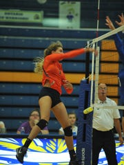 Galion's Sam Comer smashes one at the net in the third