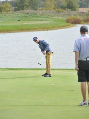Spencer Keller putts toward the cup on the 14th hole at Red Hawk in the district tournament.