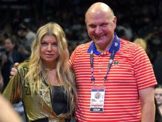Singer Fergie, left, poses with Los Angeles Clippers owner Steve Ballmer prior to an NBA basketball game against the Los Angeles Lakers, Wednesday, Jan. 7, 2015, in Los Angeles.