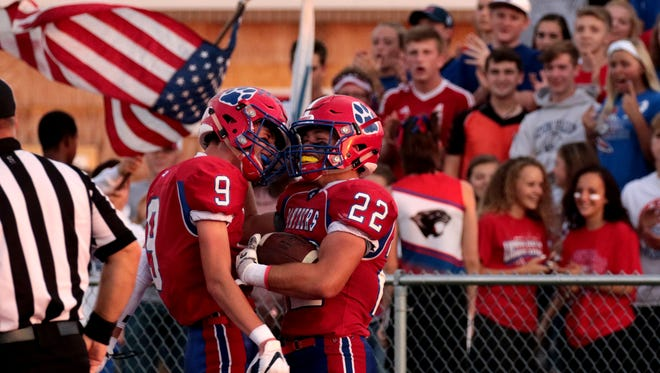 Licking Valley's Ethan Hile (9) and Connor McLaughlin (22) celebrate one of McLaughlin's three touchdowns in the Panthers' 57-20 Homecoming win over Northridge Friday night at Randy Baughman Stadium.
