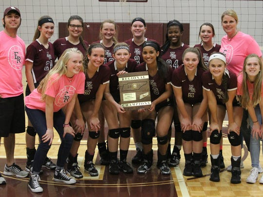 East Robertson High School volleyball players pose for a photo after winning regionals.