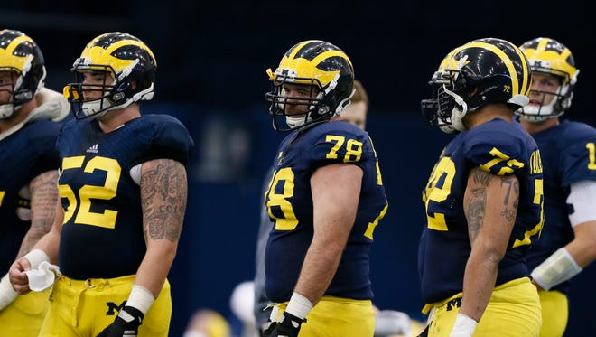 Michigan offensive linemen (left to right) Mason Cole, Erik Magnuson, and Logan Tuley-Tillman on March 19, 2015.
