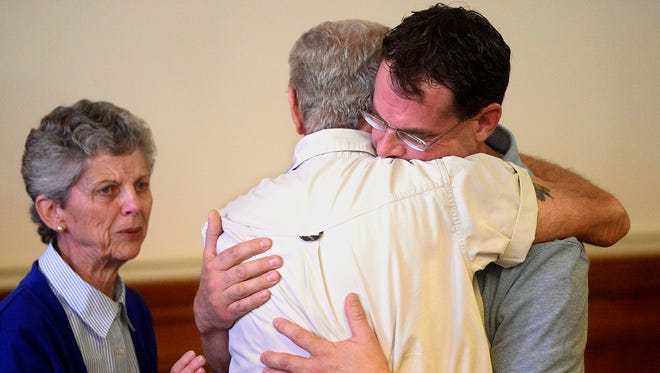 Thomas Jaraczeski hugs his father, Ron, after being found not guilty of deliberate homicide in the 1996 death of Geraldine veterinarian Dr. Bryan Rein on Wednesday afternoon in the Chouteau County Courthouse.