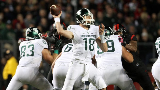 Michigan State quarterback Connor Cook led the game-winning touchdown drive against Rutgers in the final four minutes.