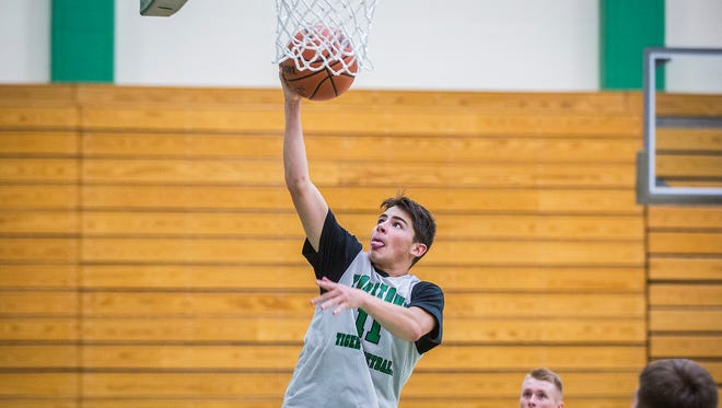 Karter Bibbs goes up for a layup during practice at Yorktown High School Wednesday, Nov. 18, 2015.