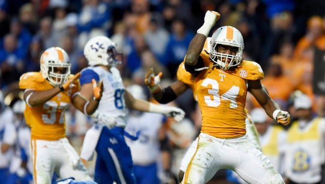 Tennessee linebacker Jalen Reeves-Maybin (34) celebrates after tackling a Kentucky player during an NCAA college football game in Knoxville, Tenn., Saturday, Nov. 15, 2014.  Tennessee won 50-16.  (AP Photo/Knoxville News Sentinel, Kevin Martin)