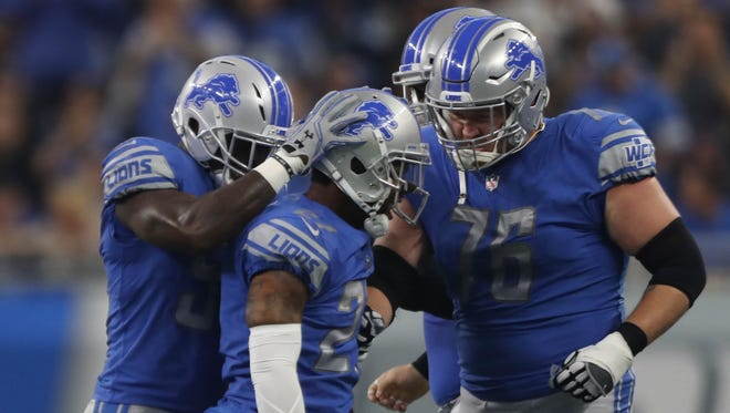The Lions congratulate Glover Quin after his interception against the Cardinals in the second quarter Sunday, Sept. 10, 2017 at Ford Field.