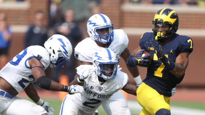 Michigan's Tarik Black runs away from Air Force defenders in the fourth quarter on Sept. 16, 2017 at Michigan Stadium.