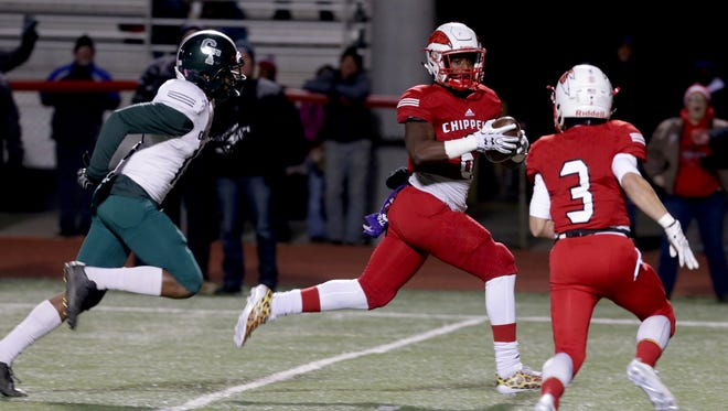 Clinton Twp. Chippewa Valley tight end Marcel Lewis runs to the end zone for the touchdown against Detroit Cass Tech at Chippewa Valley on Nov. 10, 2017.