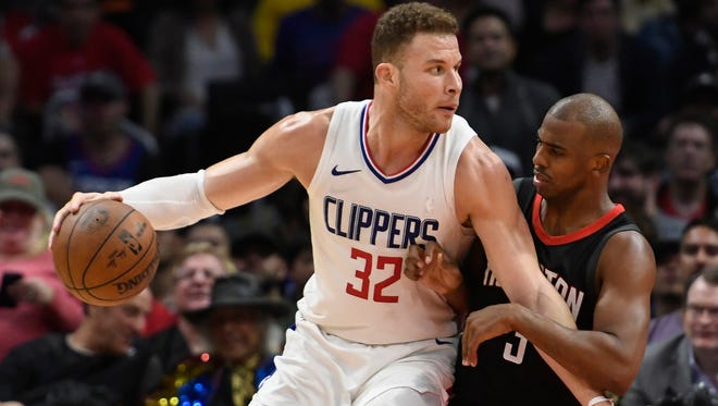 Jan 15, 2018; Los Angeles, CA, USA; Clippers forward Blake Griffin dribbles the ball as Rockets guard Chris Paul defends during the fourth quarter at Staples Center.