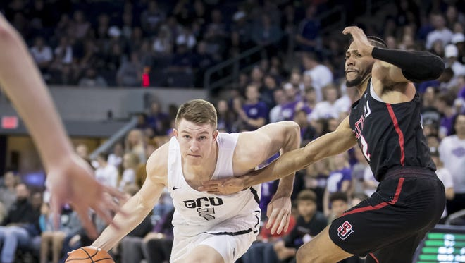 Joshua Braun (2) of Grand Canyon Antelopes drives to the basket against the Seattle Redhawks at Grand Canyon University on Thursday, February 22, 2018 in Phoenix, Arizona.