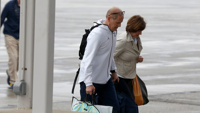 Michigan basketball coach John Beilein and his wife, Kathleen, head into the terminal at Willow Run Airport in Belleville on Tuesday, April 3, 2018. Michigan lost in the NCAA title game to Villanova the night before.