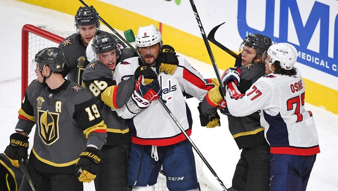 Washington Capitals left wing Alex Ovechkin is tied up with Vegas Golden Knights defenseman Nate Schmidt as players come together after a third period play at T-Mobile Arena.