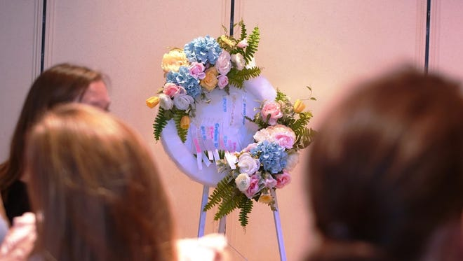 A ribbon pinning ceremony to honor babies who have died was part of the Forever in Our Hearts remembrance andbubble release Oct. 15 at Cox-Gifford Seawinds Funeral Home Chapel.