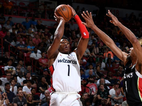 The Wizards' Admiral Schofield (1) shoots against the Hawks during a summer league game Thursday in Las Vegas.
