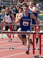 Sioux Falls Christian's Justus Adams competes in the 110 hurdle prelims during the Howard Wood Dakota Relays.