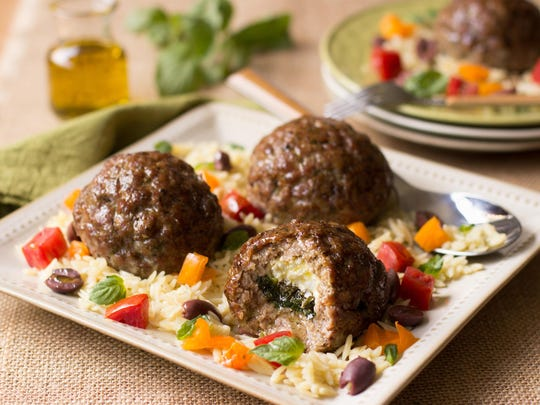 Pork meatballs are filled with chard and goat cheese stuffing.