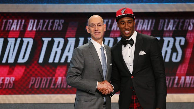 Jun 25, 2015: Rondae Hollis-Jefferson (Arizona) greets NBA commissioner Adam Silver after being selected as the number twenty-three overall pick to the Portland Trailblazers in the first round of the 2015 NBA Draft at Barclays Center.