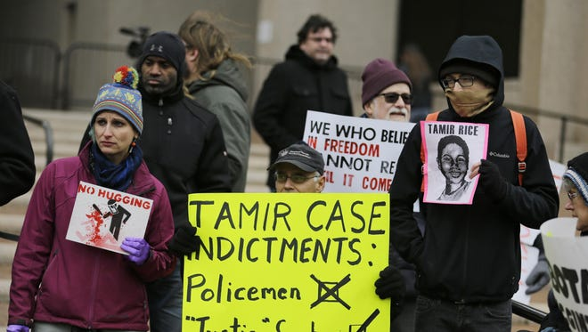 People protest outside the Cuyahoga County Justice Center on Tuesday in Cleveland. Ben Lindy writes to say the Tamir Rice case and other non-indictments in police shootings of African-Americans should serve as a wakeup call that the justice system is flawed and needs reform.