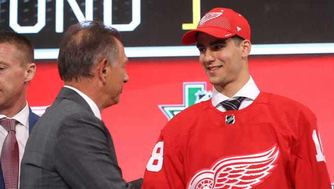 Joe Veleno talks to GM Ken Holland, after being selected 30th overall by the Detroit Red Wings at the 2018 NHL draft at American Airlines Center on June 22 in Dallas.