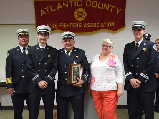 "Walter R. Kienzle Jr. of the Egg Harbor City Fire Department (center) was recognized for 50 years of service during the 25th annual Firefighters Valor Awards ceremony on April 20 at the Anthony ""Tony"" Canale Training Center. Pictured from left are Chief Walter Kienzle III, Mark Kienzle, Walter Kienzle Jr., Carol Kienzle and Michael Kienzle."